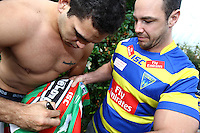 PICTURE BY VAUGHN RIDLEY/SWPIX.COM - Rugby League - Super League/NRL Preseason Preview - South Sydney Rabbitohs v Warrington Wolves - 18/11/11 - Warrington's Adrian Morley and South's Greg Inglis.