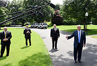 United States Secretary of State Mike Pompeo listens as US President Donald Trump speaks to the press after meeting with Kim Yong Chol, former North Korean military intelligence chief and one of leader Kim Jong Un's closest aides, on the South Lawn of the White House in Washington on Friday, June 1, 2018. <br /> CAP/MPI/RS<br /> &copy;RS/MPI/Capital Pictures