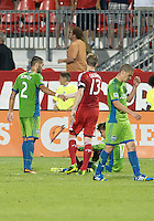 August 10, 2013: Seattle Sounders FC forward Clint Dempsey #2 shakes hands with Toronto FC defender Steven Caldwell #13 at the end of an MLS regular season game between the Seattle Sounders and Toronto FC at BMO Field in Toronto, Ontario Canada.<br /> Seattle Sounders FC won 2-1.