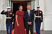 United States President Barack Obama (R) and Michelle Obama wait for President-elect Donald Trump and wife Melania at the White House before the inauguration on January 20, 2017 in Washington, D.C.  Trump becomes the 45th President of the United States.<br /> Credit: Kevin Dietsch / Pool via CNP