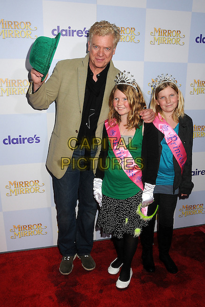 "Christopher McDonald & guests .""Mirror Mirror"" Los Angeles Premiere held at Grauman's Chinese Theatre, Los Angeles, California, USA, .17th March 2012 .full length  green hat funny hand daughters? tiara sash jacket beige jeans .CAP/ADM/BP.©Byron Purvis/AdMedia/Capital Pictures."
