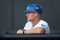 Burlington Royals manager Brooks Conrad (12) watches from the dugout during the game against the Johnson City Cardinals at Burlington Athletic Stadium on July 15, 2018 in Burlington, North Carolina. The Cardinals defeated the Royals 7-6.  (Brian Westerholt/Four Seam Images)