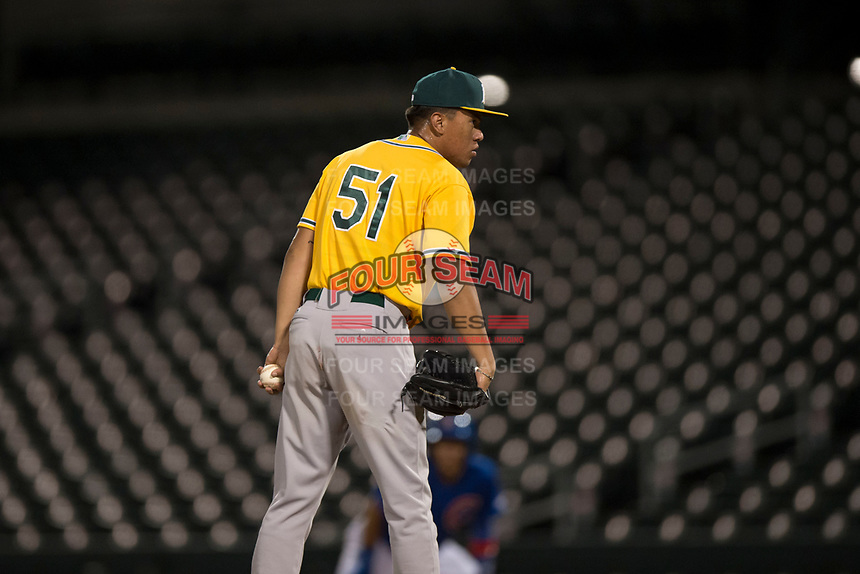 AZL Athletics relief pitcher Jorge Martinez (51) looks to his catcher for the sign during an Arizona League game against the AZL Cubs 1 at Sloan Park on June 28, 2018 in Mesa, Arizona. The AZL Athletics defeated the AZL Cubs 1 5-4. (Zachary Lucy/Four Seam Images)
