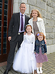 Chloe Dunnion who received her first holy communion in Duleek church pictured with parents Michael and Aoife and sister Holly. Photo:Colin Bell/pressphotos.ie