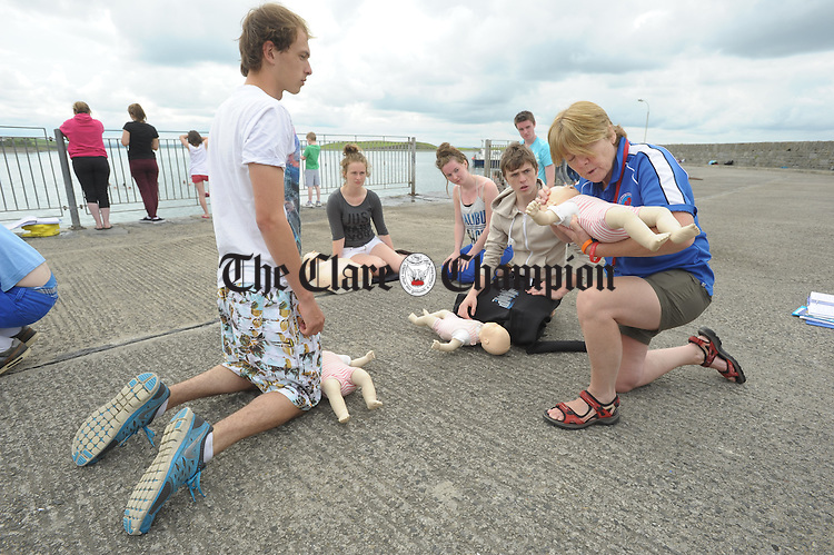 Margaret Talty, water safety examiner with trainees Tom Bermingham, Catherine Brew Quinn, Kate Tobin and Jordan O Looney doing a Rescue 4 Award course as part of their lifesaving and Water Safety classes at Cappa, Kilrush, run by the Clare Water Safety Association. Photograph by John Kelly.