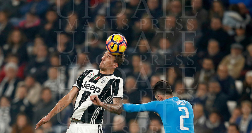 Calcio, Serie A: Juventus Stadium. Torino, Juventus Stadium, 29 ottobre 2016.<br /> Juventus' Mario Mandzukic, left, is challenged by Napoli's Elseid Hysaj during the Italian Serie A football match between Juventus and Napoli at Turin's Juventus Stadium, 29 October 2016. Juventus won 2-1.<br /> UPDATE IMAGES PRESS/Isabella Bonotto