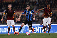 Calcio, Serie A: Roma vs Inter. Roma, stadio Olimpico, 19 marzo 2016.<br /> FC Inter&rsquo;s Marcelo Brozovic, center, is challenged by Roma&rsquo;s Seydou Keita, right, during the Italian Serie A football match between Roma and FC Inter at Rome's Olympic stadium, 19 March 2016. The game ended 1-1.<br /> UPDATE IMAGES PRESS/Isabella Bonotto
