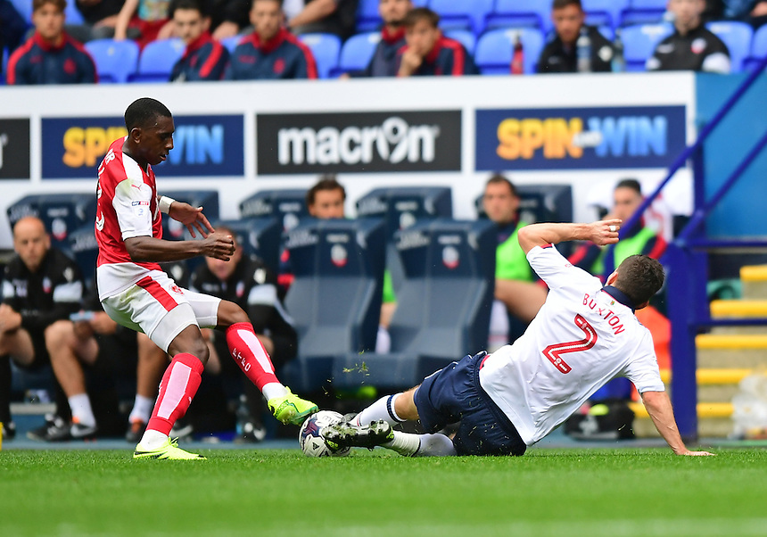 Fleetwood Town's Amari'i Bell is tackled by Bolton Wanderers's Lewis Buxton<br /> <br /> Photographer Chris Vaughan/CameraSport<br /> <br /> Football - The EFL Sky Bet League One - Bolton Wanderers v Fleetwood Town - Saturday 20 August 2016 - Macron Stadium - Bolton<br /> <br /> World Copyright &copy; 2016 CameraSport. All rights reserved. 43 Linden Ave. Countesthorpe. Leicester. England. LE8 5PG - Tel: +44 (0) 116 277 4147 - admin@camerasport.com - www.camerasport.com