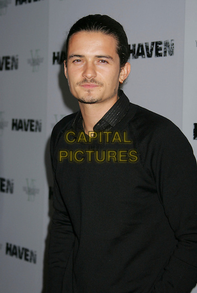"ORLANDO BLOOM.""Haven"" Premiere held at at the ArcLight Cinemas, Hollywood, California, USA..Septmeber 12th, 2006.Ref: ADM/RE.half length black shirt.www.capitalpictures.com.sales@capitalpictures.com.©Russ Elliot/AdMedia/Capital Pictures."