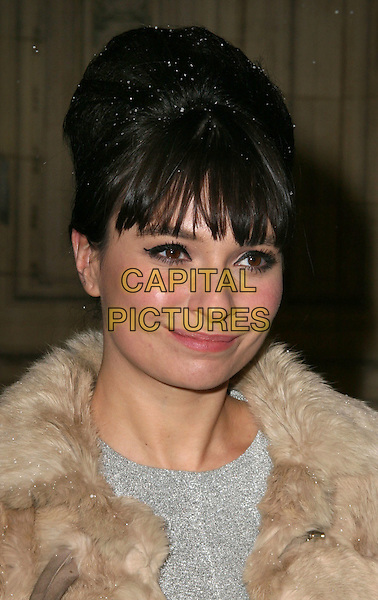 GIZZI ERSKINE.Gala VIP Opening Night of Cirque du Soleil's 'Varekai' at the Royal Albert Hall, London, England, UK, January 5th 2010..arrivals portrait headshot beige fur hair up fringe snowing snow cream .CAP/JIL.©Jill Mayhew/Capital Pictures
