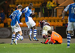 St Johnstone v Hearts..15.12.12      SPL.Jamie MacDonald blocks Gregory Tade's shots at goal.Picture by Graeme Hart..Copyright Perthshire Picture Agency.Tel: 01738 623350  Mobile: 07990 594431