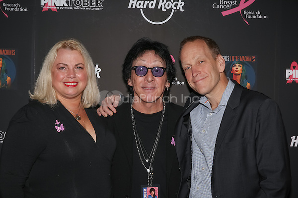 New York, NY - September 30 : (L-R), Chief Communications & Engagement Officer from Breast Cancer Research Foundation Stephanie Kauffman, Former KISS Drummer Peter Criss and CMO of Hard Rock International John Galloway attend  Hard Rock Fights Breast Cancer through PINKTOBER with Lights Concert and special appearance by Peter Criss held at the Hard Rock Cafe in Times Square on September 30, 2014 in New York City. (Photo by Brent N. Clarke / MediaPunch)