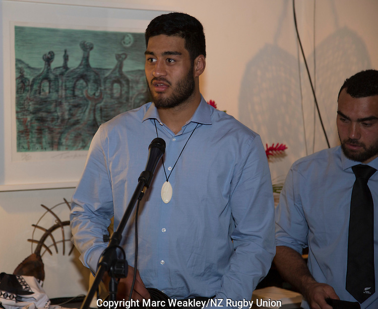 Akira Ioane receives his official debutant's Maori All Blacks tie at the post-match function at the NZ High Commission. At right is Captain Charlie Ngatai. Maori All Blacks vs. Fiji. Suva. July 11, 2015. Photo: Marc Weakley