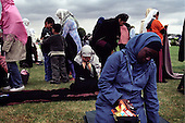 """British Muslims pray at the four-day """"Living Islam"""" festival in northern England in July 2005.....The event, attended by thousands of mainly Pakistani Muslims across the UK, takes place in the Showground of Lincoln, one of England's great cathedral cities.....The event was organised by the Islamic Society of Britain and takes place co-incidentally days after the London bombings by purported Islamic extremists. Organisers said the gathering was a symbol of Muslims celebrating the true meaning of Islam.....There were activities for the family including music, entertainment, sports and speeches. .."""