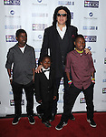 Gene Simmons and patients of Mending Kids at the Mending Kids Gala Honoring Gene Simmons and family, held at the Santa Monica Airport Hanger 8 on November 9, 2013