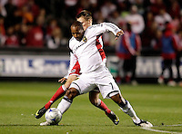Real Salt Lake midfielder Robbie Willams (77) control the ball while holding off Chicago Fire midfielder Chris Rolfe (17).  Real Salt Lake defeated the Chicago Fire in a penalty kick shootout 0-0 (5-4 PK) in the Eastern Conference Final at Toyota Park in Bridgeview, IL on November 14, 2009.