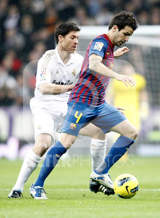 Real Madrid's Xabi Alonso against Barcelona's Cesc Fabregas during La Liga Match. December 10, 2011. (ALTERPHOTOS/Alvaro Hernandez)