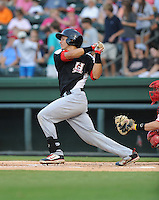 Catcher Jorge Alfaro (11) of the Hickory Crawdads in a game against the Greenville Drive on Sunday, September 2, 2012, at Fluor Field at the West End in Greenville, South Carolina. Alfaro is the Texas Rangers' No. 7 prospect, according to Baseball America. Hickory won, 8-4. (Tom Priddy/Four Seam Images)