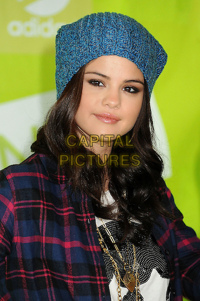 Selena Gomez.Adidas NEO Label Signs Selena Gomez as New Style Icon and Designer held at 1745 E 7th Street, Los Angeles, California, USA..November 20th, 2012.headshot portrait blue knitted beanie hat red lumberjack shirt check gold necklaces .CAP/ADM/BP.©Byron Purvis/AdMedia/Capital Pictures.
