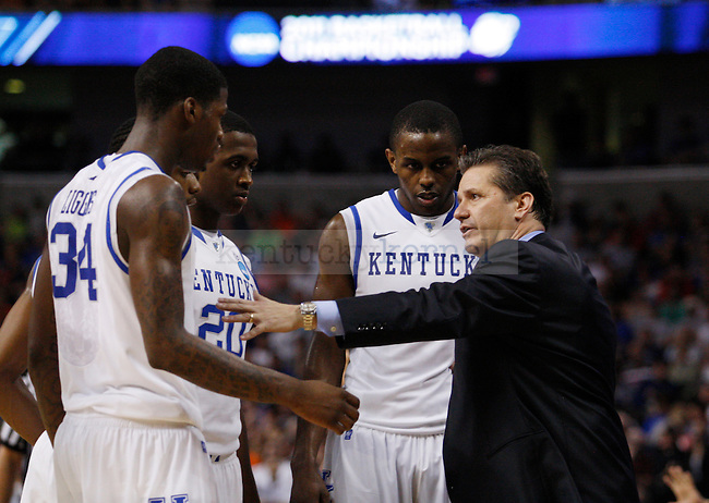 Coach Cal talks with the team in the final 30 seconds of the second half of UK's second round NCAA tournament win, 71-63, against West Virginia at the St. Pete Times Forum in Tampa, Florida on Saturday, March 19, 2011.  Photo by Britney McIntosh | Staff
