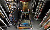 Dali returns to Glasgow - Dali's iconic painting Christ of St John of the Cross has returned to Glasgow after its six-month loan to The High Museum of Atlanta. The painting - seen here being removed from its transit container at Glasgow Museums Resource Centre - will return to Kelvingrove in Spring 2011 - Picture by Donald Macleod - 25.1.11 - 07702 319 738 - www.donald-macleod.com