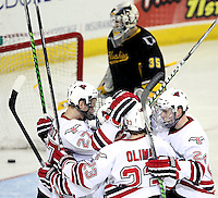 UNO players celebrate a goal by Matt Ambroz (No. 27) during the third period. UNO defeated Michigan Tech 3-1 Friday night at Qwest Center Omaha. (Photo by Michelle Bishop)