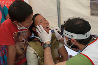 A woman receives treatment in a Medical camp at Bhaktapur, near Kathmandu, Nepal. May 03, 2015