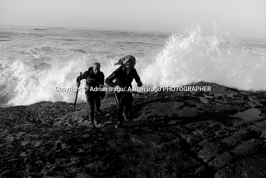 "Several percebeiros collect barnacles off the coast of Baiona on November 28, 2011. The art of shellfish in Galicia emerged as an alternative to poor and unprofitable agricultural economy. The seafood subsequently become the livelihood of the poorest peasants. Farmers moved techniques and tools plowing the rocks and beaches that make up the Galician coast in a survival exercise. With the passage of time and the achievement of a society with food needs covered what was once ""poor food"" today it is for the rich. © Adrián Irago"