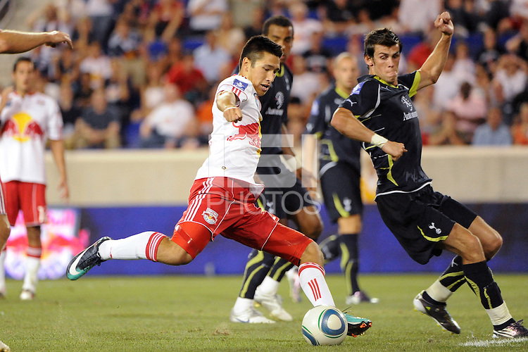 Connor Chinn (25) of the New York Red Bulls takes a shot. Tottenham Hotspur F. C. defeated the New York Red Bulls 2-1 during a Barclays New York Challenge match at Red Bull Arena in Harrison, NJ, on July 22, 2010.