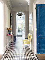 The long entrance hall is lined with the original black-and-white ceramic tiles laid in a simple geometric pattern