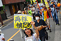 """Tokyo, Japan - June 17: A woman held a sign, which said """"Don't Restart,"""" against nuclear power plants in Japan during a demonstration at Mitaka, Tokyo, Japan on June 17, 2012. As Japanese Government decided to restart Oi Nuclear Power Plants No.3 and 4 in Fukui, people spoke up against the restart throughout the nation. ."""