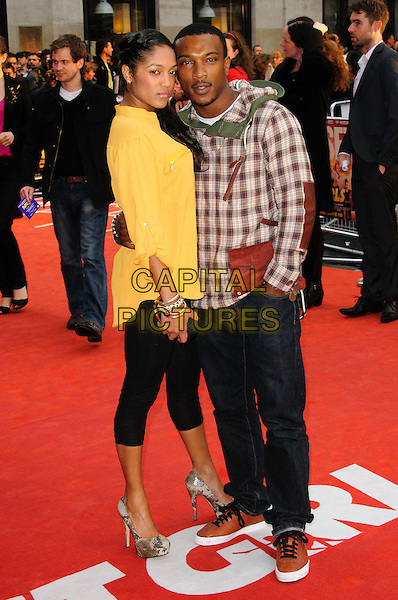 guest & Ashley Walters.The 'Fast Girls' UK film premiere, Odeon West End cinema, Leicester Square, London, England..June 7th, 2012.full length yellow top brown white check jacket leggings.CAP/CJ.©Chris Joseph/Capital Pictures.