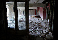 Looting and vandalism in the deserted Hotel Polisye (Polissia?) in Pripyat. <br /> Pripyat was built 1970 as a modern city for personnel at the Chernobyl Nuclear Power Plant a couple of kilometers south. After the nuclear disaster at reactor 4 on April 26 1986, the town's 48.000 inhabitants was evacuated to other parts of the country. Pripiat is today a radioactive ghost town. The whole area is contamined with nuclear material, the half-life of plutonium-239 is more than 24.000 years.<br /> Pripyat, Ukraine.<br /> August 2008.