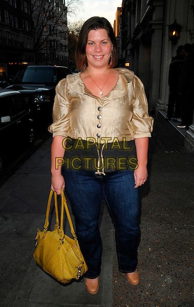 KATIE BRAND.The End Of Summer Ball in Berkeley Square launch party, Nobu restaurant, London, England..April 7th, 2008.full length jeans denim gold jacket black top yellow bag purse metallic .CAP/CAN.©Can Nguyen/Capital Pictures.