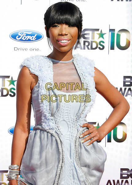 BRANDY NORWOOD.The 2010 BET Awards at the Shrine Auditorium in Los Angeles, California, USA. .June 27th, 2010 .half length grey gray silver dress fringe bangs hair sleeveless sheer hand on hip frills ruffle.CAP/RKE/DVS.©DVS/RockinExposures/Capital Pictures.
