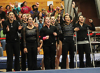 STANFORD, CA--March 1, 2013--Members of the Stanford women's Gymnastics team celebrate during the competition against Cal and Oregon State University on the Stanford University Campus. Stanford won the competition .