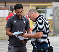 Lincoln City's Bruno Andrade signs autographs for fans after arriving at the grounf<br /> <br /> Photographer Chris Vaughan/CameraSport<br /> <br /> The EFL Sky Bet League One - Lincoln City v Fleetwood Town - Saturday 31st August 2019 - Sincil Bank - Lincoln<br /> <br /> World Copyright © 2019 CameraSport. All rights reserved. 43 Linden Ave. Countesthorpe. Leicester. England. LE8 5PG - Tel: +44 (0) 116 277 4147 - admin@camerasport.com - www.camerasport.com