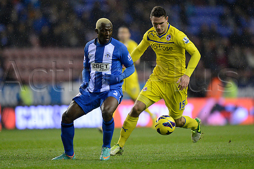 24.11.2012 Wigan, England.  Sean Morrison  of Reading and Arouna Kone  of Wigan in action during the Premier League game between Wigan Athletic and Reading at the DW Stadium.