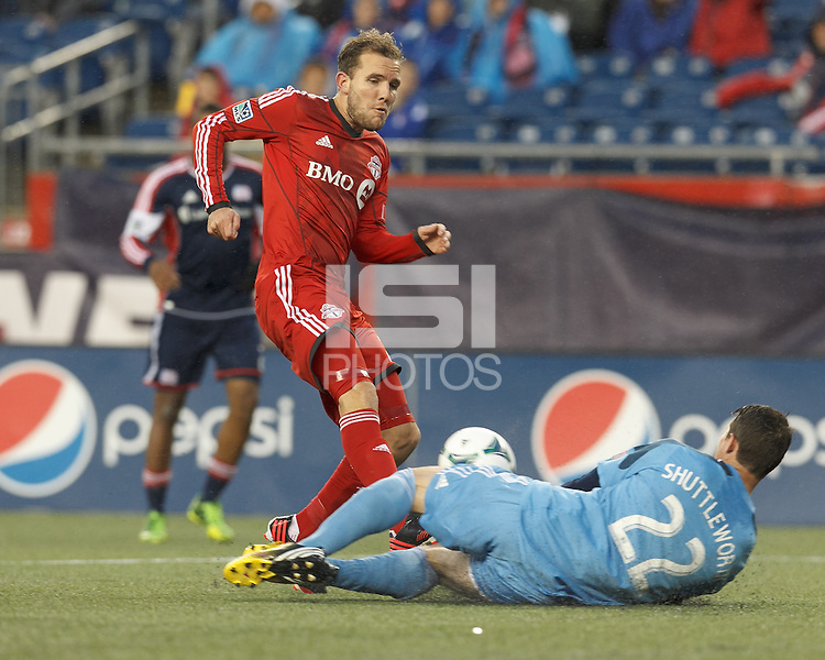 New England Revolution goalkeeper Bobby Shuttleworth (22) thwarts Toronto FC forward Jeremy Brockie (22) drive for the net. In a Major League Soccer (MLS) match, the New England Revolution (blue) defeated Toronto FC (red), 2-0, at Gillette Stadium on May 25, 2013.