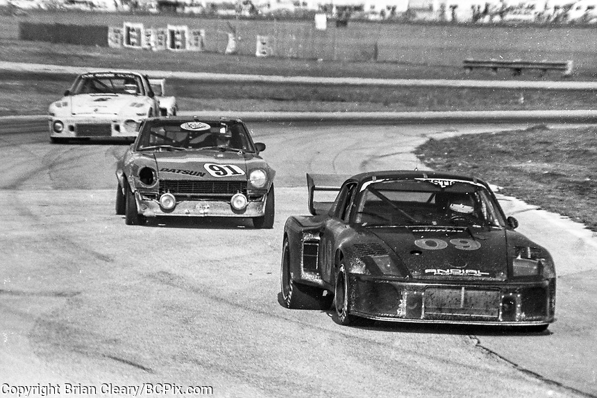 #09 Porsche 934 of Gary Belcher, Doc Bundy, and Al Holbert 6th place finish and the #91 Datsun 260Z of  Bill Cooper, Bob Bondurant, Steve Cook, and Ron Southern  24th place finish, 1978 24 Hours of Daytona, Daytona International Speedway, Daytona Beach, FL, February 5, 1978.  (Photo by Brian Cleary/www.bcpix.com)