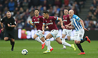 West Ham United's Javier Hernandez and Huddersfield Town's Aaron Mooy<br /> <br /> Photographer Rob Newell/CameraSport<br /> <br /> The Premier League - West Ham United v Huddersfield Town - Saturday 16th March 2019 - London Stadium - London<br /> <br /> World Copyright © 2019 CameraSport. All rights reserved. 43 Linden Ave. Countesthorpe. Leicester. England. LE8 5PG - Tel: +44 (0) 116 277 4147 - admin@camerasport.com - www.camerasport.com