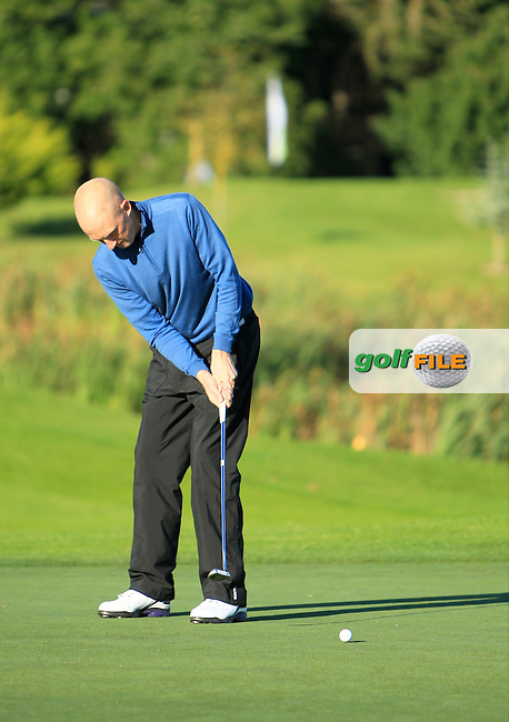 Mark Staunton (Ballinasloe G.C) on the 12th green during Round 1 of The Cassidy Golf 103rd Irish PGA Championship in Roganstown Golf Club on Thursday 10th October 2013.<br /> Picture:  Thos Caffrey / www.golffile.ie