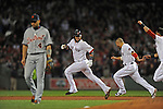 Detroit Tigers second baseman Omar Infante, left, heads for the showers as Boston Red Sox's Jarrod Saltalamacchia (39) is chased down by teammates Shane Victorino and Jacoby Ellsbury after Saltalamacchia hits a walk-off single to beat the Detroit Tigers 6-5 in Game 2 of Major League Baseball's American League Championship Series at Fenway Park on Sunday, October 13, 2013. Photo by Christopher Evans