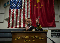 111227-N-DR144-753 HONG KONG (Dec. 27, 2011) Commanding Officer Capt. Kent D. Whalen delivers remarks during a reception for Hong Kong guests in the hangar bay aboard Nimitz-class aircraft carrier USS Carl Vinson (CVN 70). The Carl Vinson Strike Group is currently anchored in Hong Kong Harbor for a port visit.  (U.S. Navy photo by Mass Communication Specialist 2nd Class James R. Evans/Released)