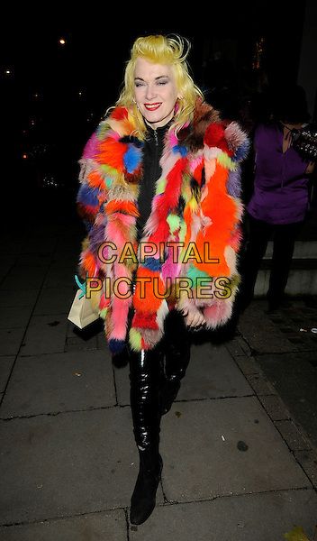 PAM HOGG .At the Switching on of the Stella McCartney Store Christmas Lights, Bruton Street, London, England, UK, November 23rd 2009..full length multi-coloured fur coat jacket pink red blue green black  pvc shiny trousers .CAP/CAN.©Can Nguyen/Capital Pictures.