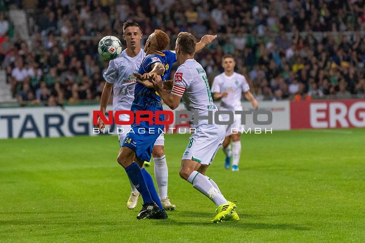 10.08.2019, wohninvest Weserstadion, Bremen, GER, DFB-Pokal, 1. Runde, SV Atlas Delmenhorst vs SV Werder Bremen<br /> <br /> DFB REGULATIONS PROHIBIT ANY USE OF PHOTOGRAPHS AS IMAGE SEQUENCES AND/OR QUASI-VIDEO.<br /> <br /> im Bild / picture shows<br /> <br /> Marco Friedl (Werder Bremen #32)<br /> Marvin Osei (SV Atlas Delmenhorst #24)<br /> Niklas Moisander (Werder Bremen #18)<br /> Foto © nordphoto / Kokenge