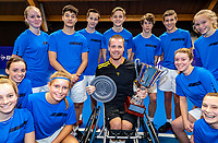 Alphen aan den Rijn, Netherlands, December 22, 2019, TV Nieuwe Sloot,  NK Tennis, Wheelchair men single final: Winner Maikel Scheffers (NED) celebrates his win with the ballkids<br /> Photo: www.tennisimages.com/Henk Koster
