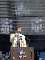 Troy Aikman, former quarterback for the Dallas Cowboys, gives a thumbs to the crowd as they cheer during his induction into the Pro Football Hall of Fame Saturday, Aug. 5, 2006, in Canton, Ohio.<br />