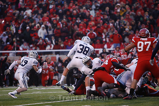 Trent Nelson  |  The Salt Lake Tribune..Brandon Burton blocks a field goal attempt by BYU kicker Mitch Payne (38) to win. Utah beats BYU on a blocked field goal attempt at Rice-Eccles Stadium Saturday, November 27, 2010. The final score was Utah 17-BYU 16.