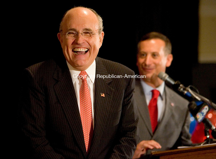 WATERBURY, CT- 01 OCTOBER 2008 --100108JS05--Former New York City Mayor Rudy Giuliani laughs as Sen. David Cappiello's, R-Danbury, a candidate for the Congressional 5th District, suggests Giuliani try to convert his wife, a Red Sox fan, into a Yankees fan. Giuliani was on hand for a fund raiser for Cappiello Wednesday at the Ponte Club in Waterbury. Cappiello is running against Democratic Congressman Chris Murphy.<br /> Jim Shannon / Republican-American